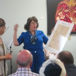 Gloria Golbert presents Award